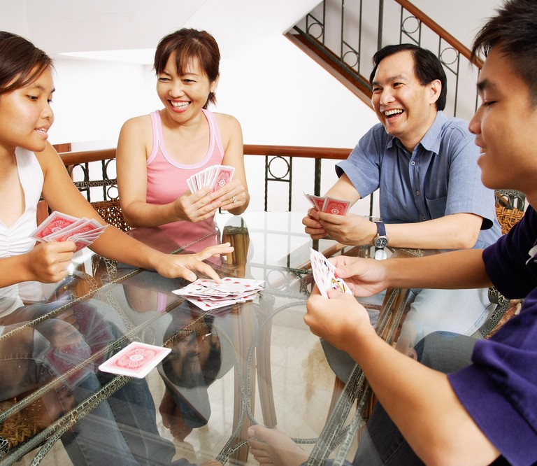 family-home-playing-cards-around-table